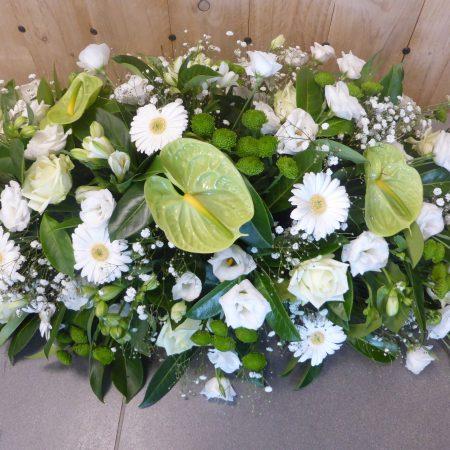 Raquette de fleurs coupées blanc et vert